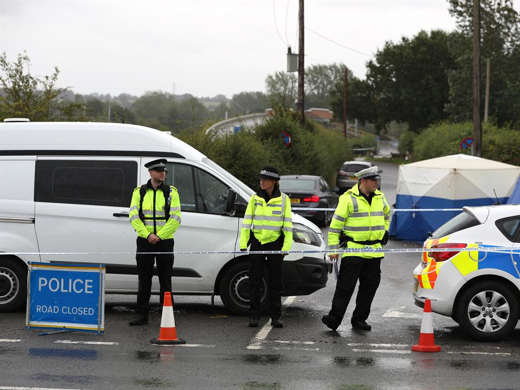 Investigation The road remained cordoned off as investigators looked for clues
