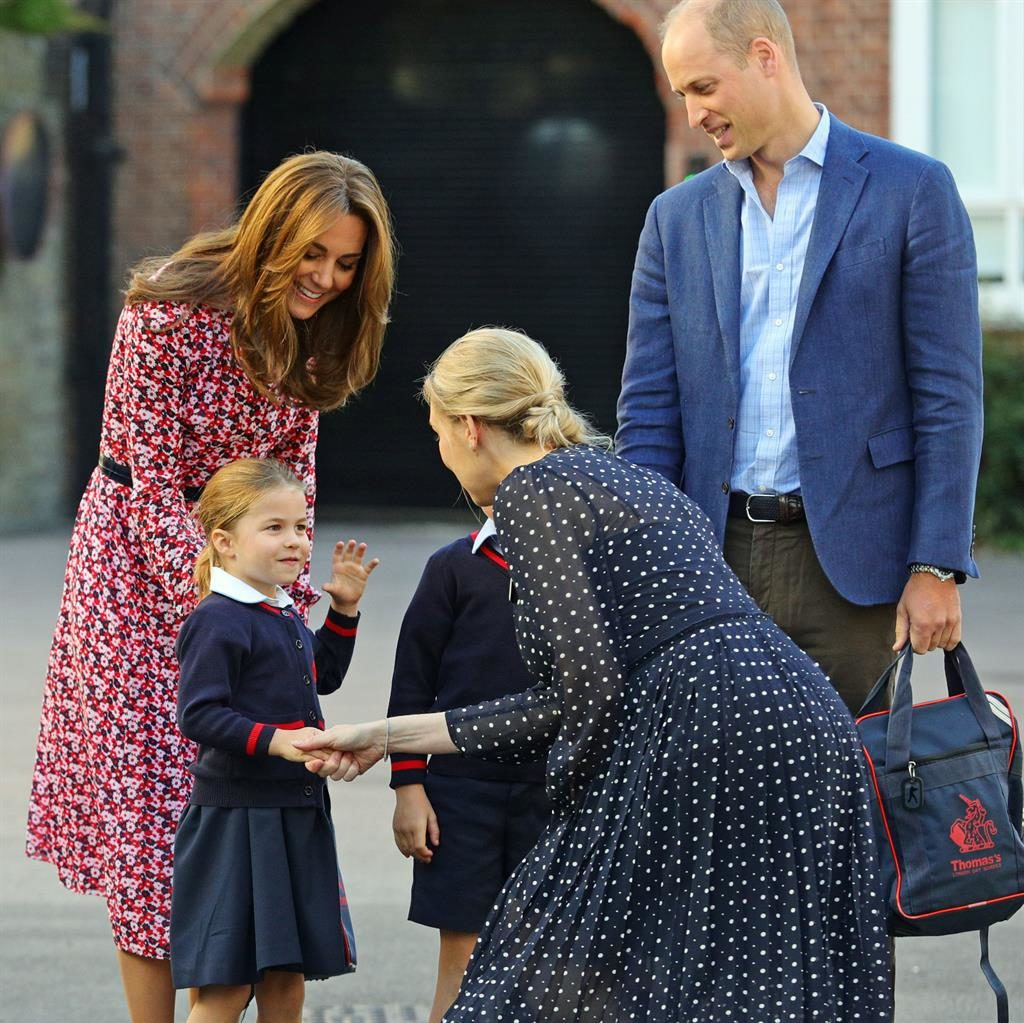Hands-on approach: Charlotte is greeted by lower school head Helen Haslam as her proud mum and dad drop her off PICTURES: PA
