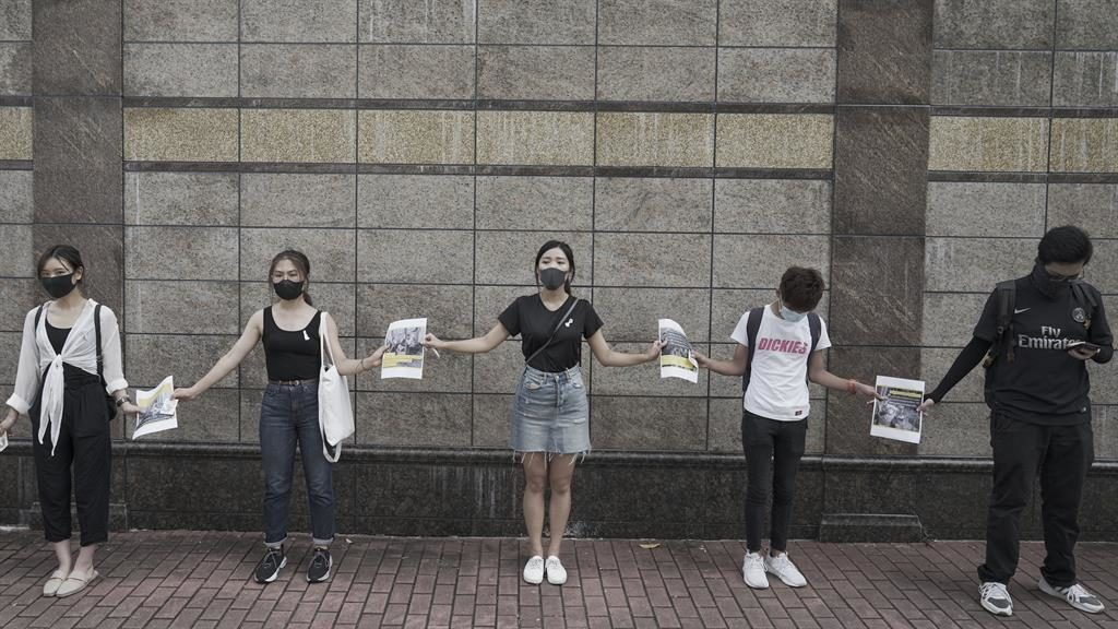 Chain reaction: University students holding hands