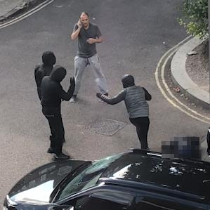 Left to die: A man who may have shot himself is left in street as three masked men run off when witness dials for help