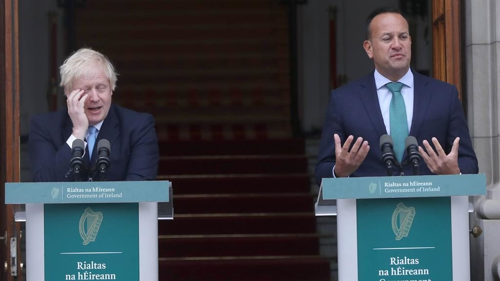 Body language: Boris Johnson listens as Leo Varadkar (right) tells him Ireland has yet to see a realistic backstop alternative PICTURES: PA/GETTY
