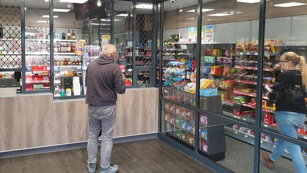 Keeping them out: Bulletproof glass stops customers picking up stock and has slashed crime in one Basildon store PICTURE: BPM