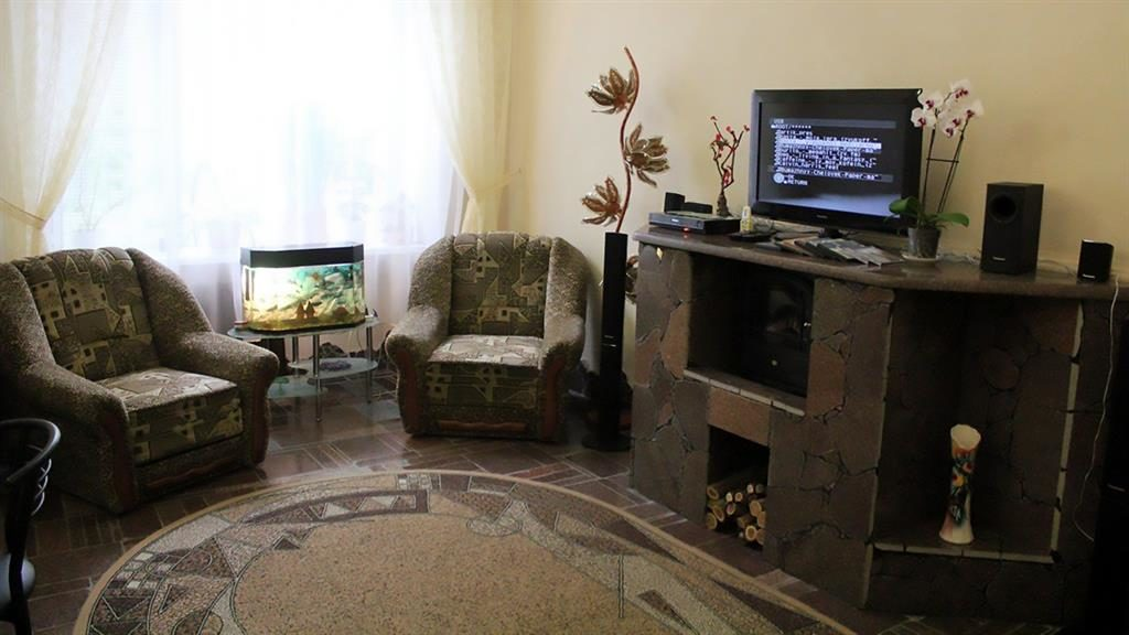 Cosy: The Pokrov jail's common room has a log fire
