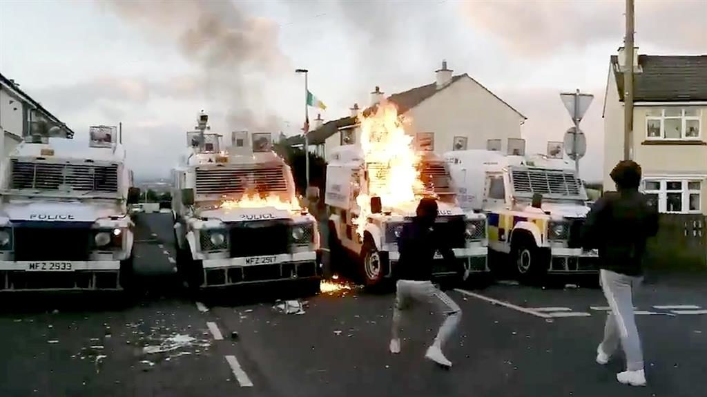 Violence: Dissidents hurl petrol bombs at armoured police vans in Londonderry after officers found an explosive device on the Creggan Estate