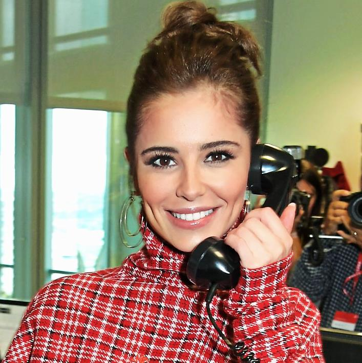 Checks and the City: Cheryl adds trade-mark chic PICTURE: GETTY