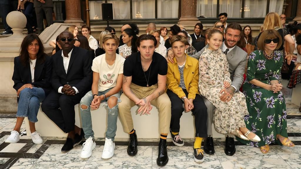 In Vogue: Emmanuelle Alt [left], Edward Enninful, Romeo, Brooklyn, Cruz, Harper, Becks and Anna Wintour in front row PICTURE: WIREIMAGE