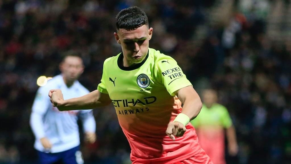 Phil-good: Foden got a rare chance to showcase his talents at Preston and sees Sterling (below) as an inspiration PICTURES: REX