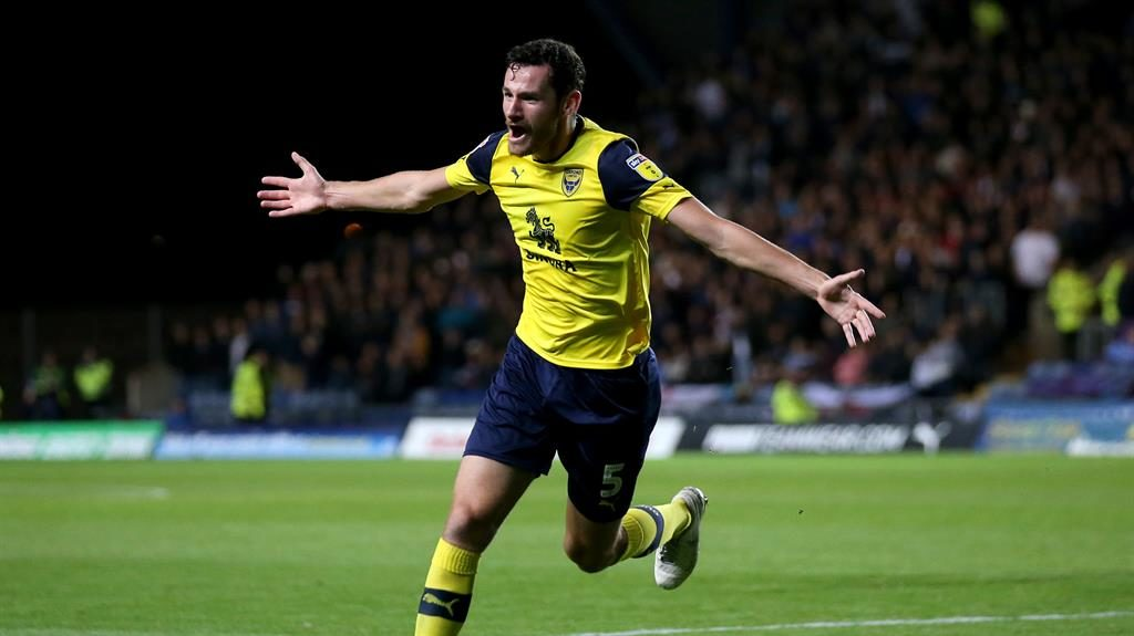 Ell of a finish: Moore celebrates Oxford's opening goal against the Hammers PICTURE: PA