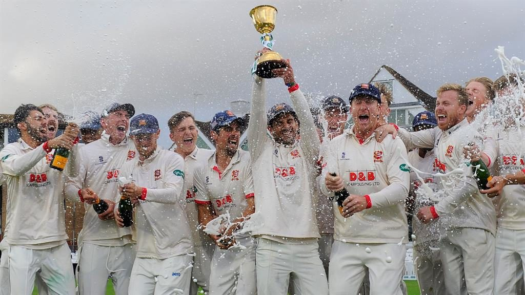 Glory: Essex players celebrate after landing the title again, while Trescothick (below) retired PICTURE: REX