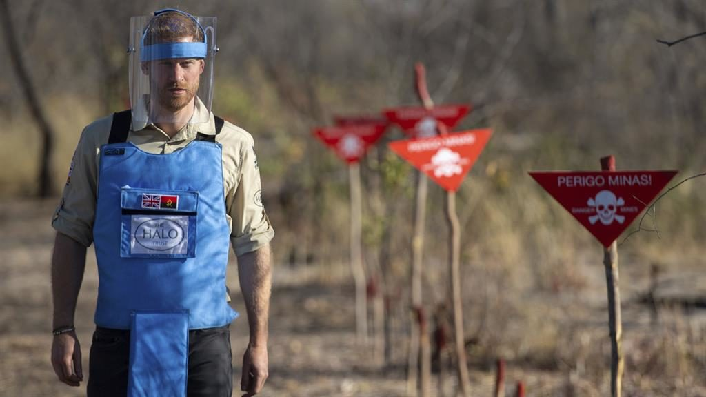 Dedicated to the cause: Prince Harry walks through a minefield in Dirico, Angola, earlier today PICTURES: AP