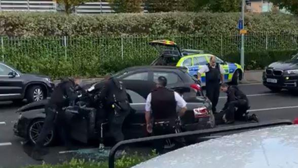 Gunpoint: Armed police pull one of the teenagers from the stolen Audi