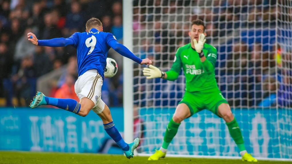 Down and rout: Vardy heads his second as Leicester humbled Newcastle 5-0 at the King Power yesterday PICTURE: REX