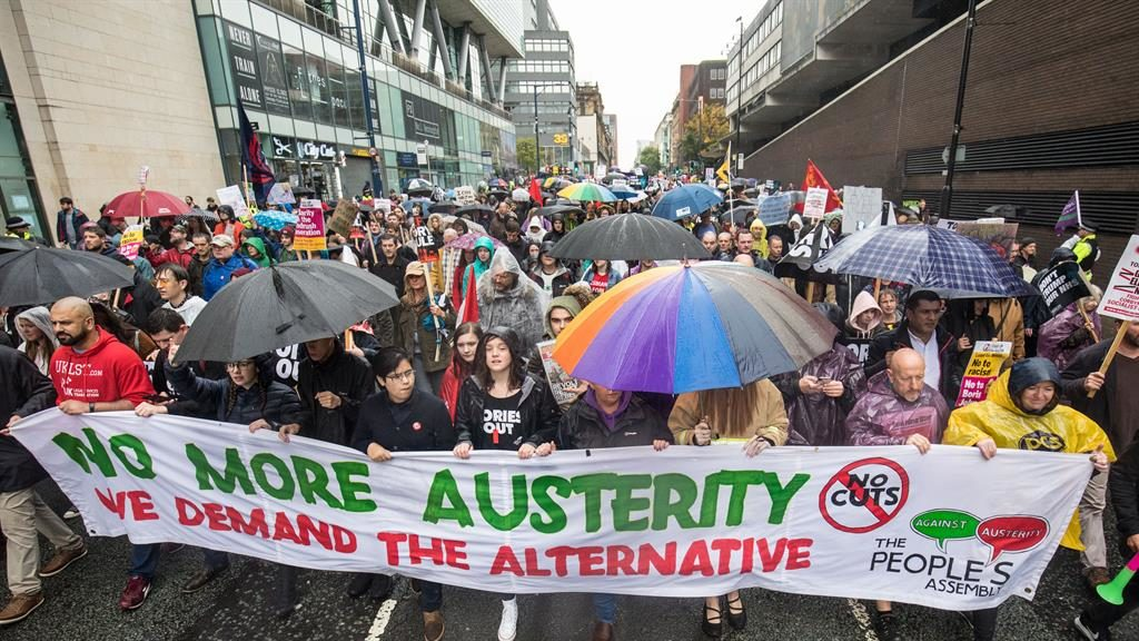 Brolly brigade: Anti-Tory marchers brave the elements PICTURE: MERCURY