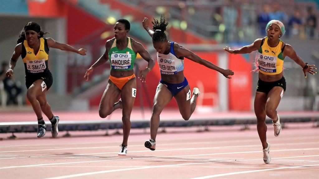 Cutting a dash: Asher-Smith (second right) dips for the line but Fraser-Pryce (right) is just too good PICTURES: PA