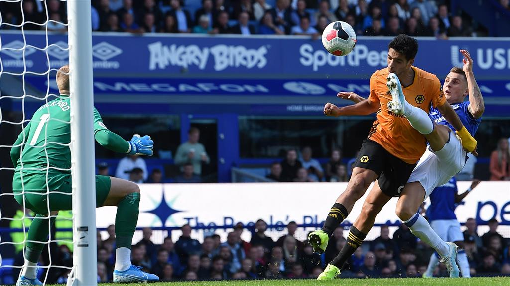 Foot fault Jimenez nets despite a boot in the face
