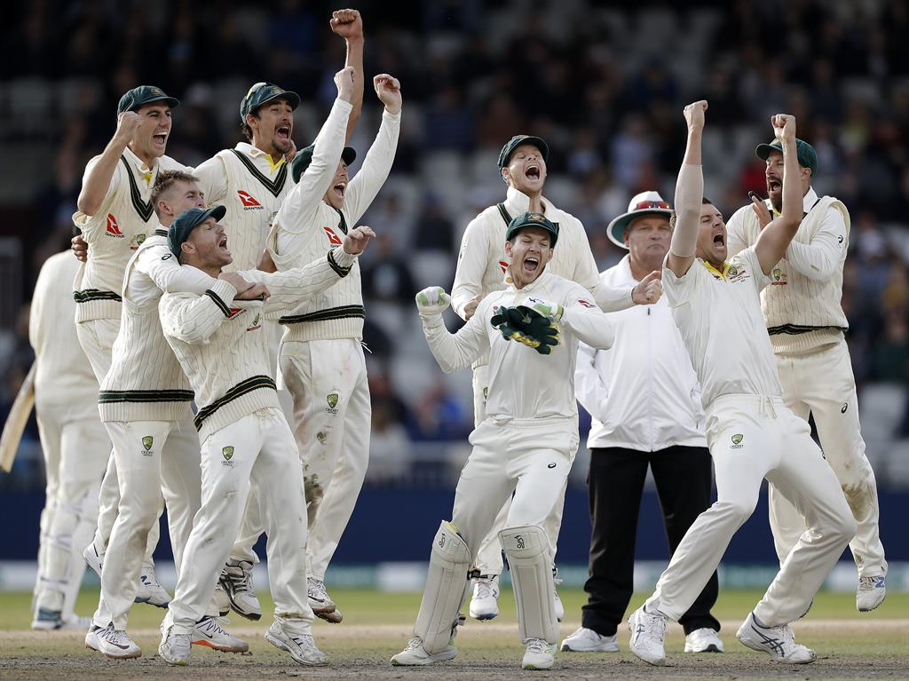 Winning roar Australia celebrate keeping hold of the urn