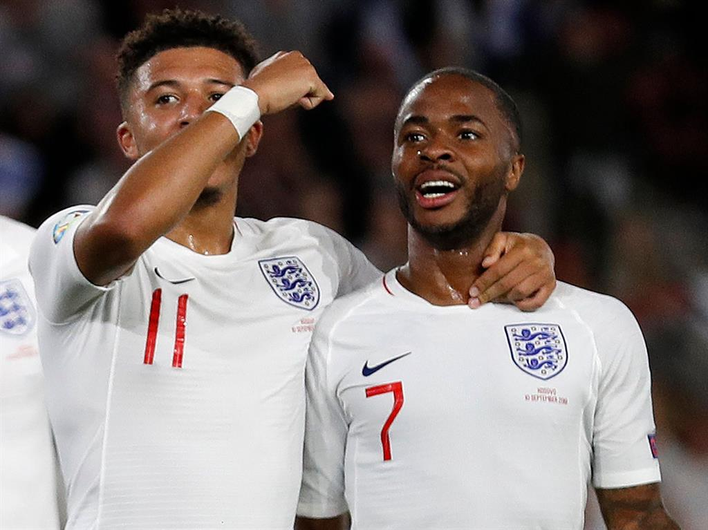 Winning mentality Jadon Sancho celebrates with England's midfielder Raheem Sterling after scoring his second goal