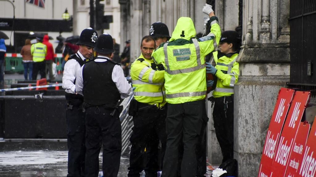 Tragedy prevented: Police detain the man while medics respond to the incident PICTURE: AP