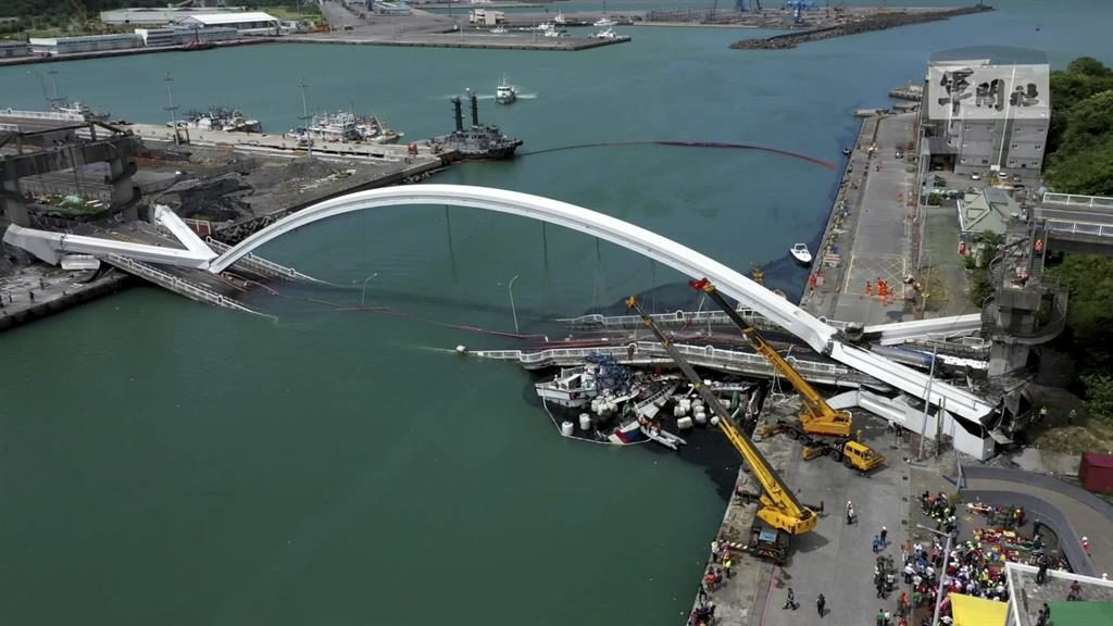 Brought down: The collapsed Nanfangao Bridge lies in ruins as rescuers search for victims PICTURES: AP