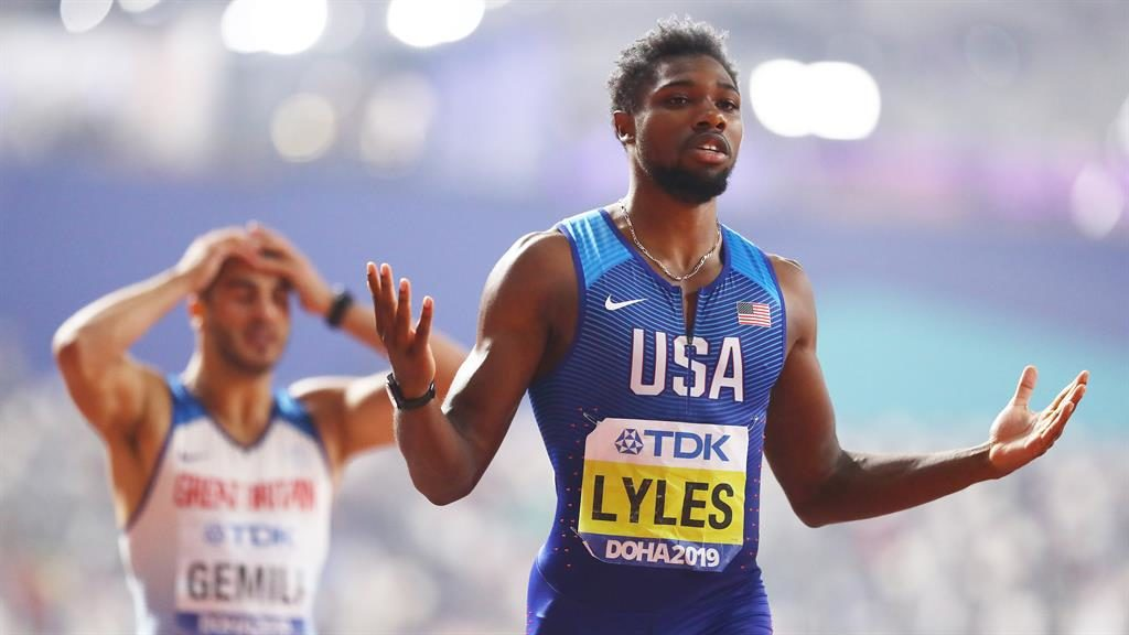 So close: Lyles enjoys his victory as Gemili is left distraught after missing out on a medal PICTURE: GETTY