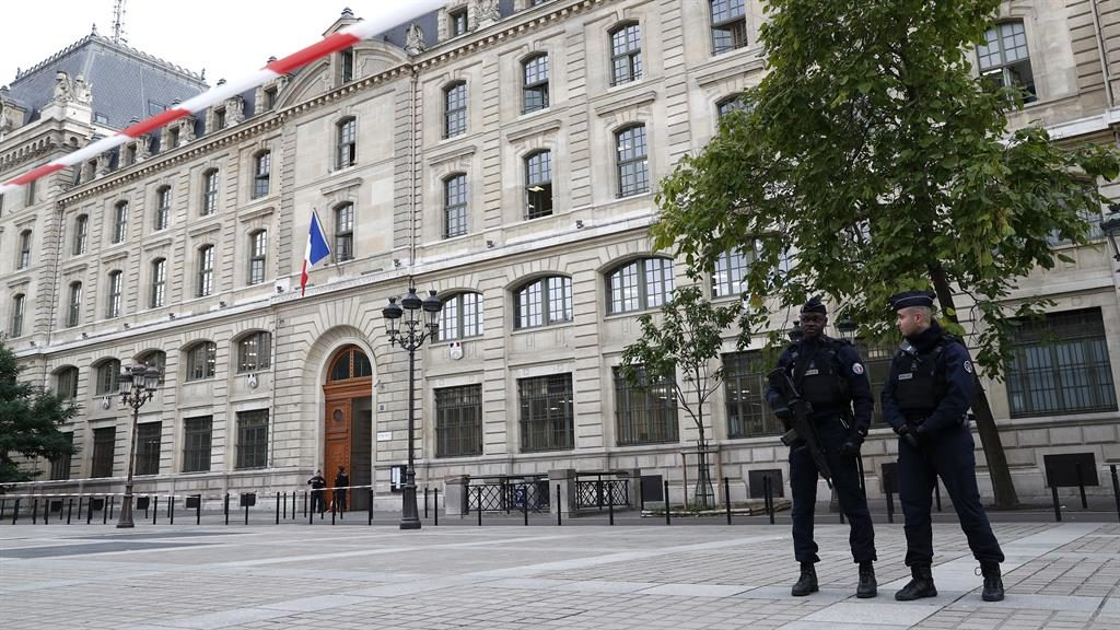 Lockdown: French police establish a security perimeter near Paris police headquarters after this morning's attack PICTURE: EPA