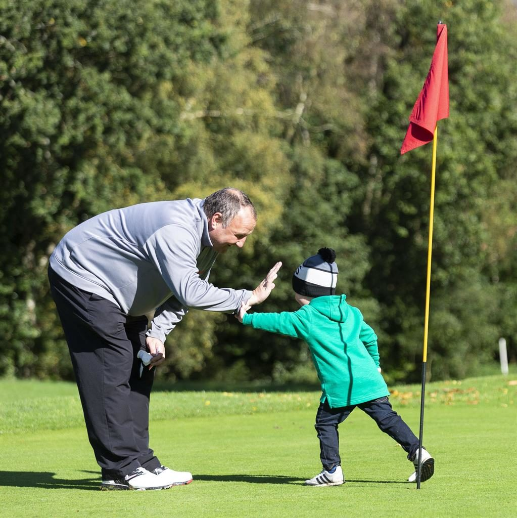 Swing-credible: Tony Sedgwick with golf-mad grandson George (below, driving off) PICTURES: SWNS