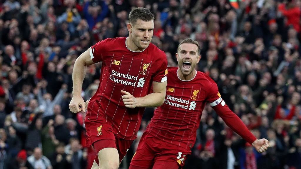 Never say die: Milner (left) and Jordan Henderson celebrate Liverpool's late winner PICTURE: REX