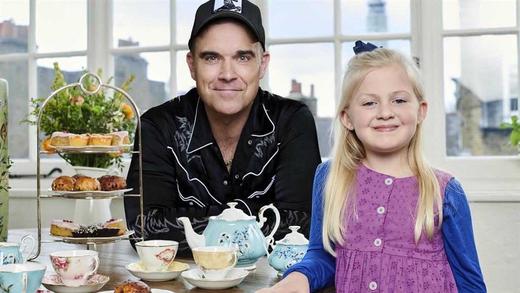 Tea time: Robbie Williams with Clara Ross, who will make her TV debut as Sophie in The Tiger Who Came to Tea PICTURE: PA