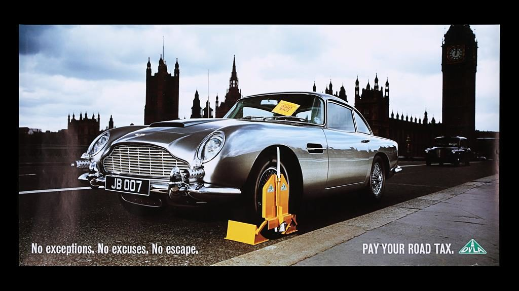 Lots of action: This James Bond-themed DVLA poster from 2001 is part of the collection going up for auction PICTURES: SWNS