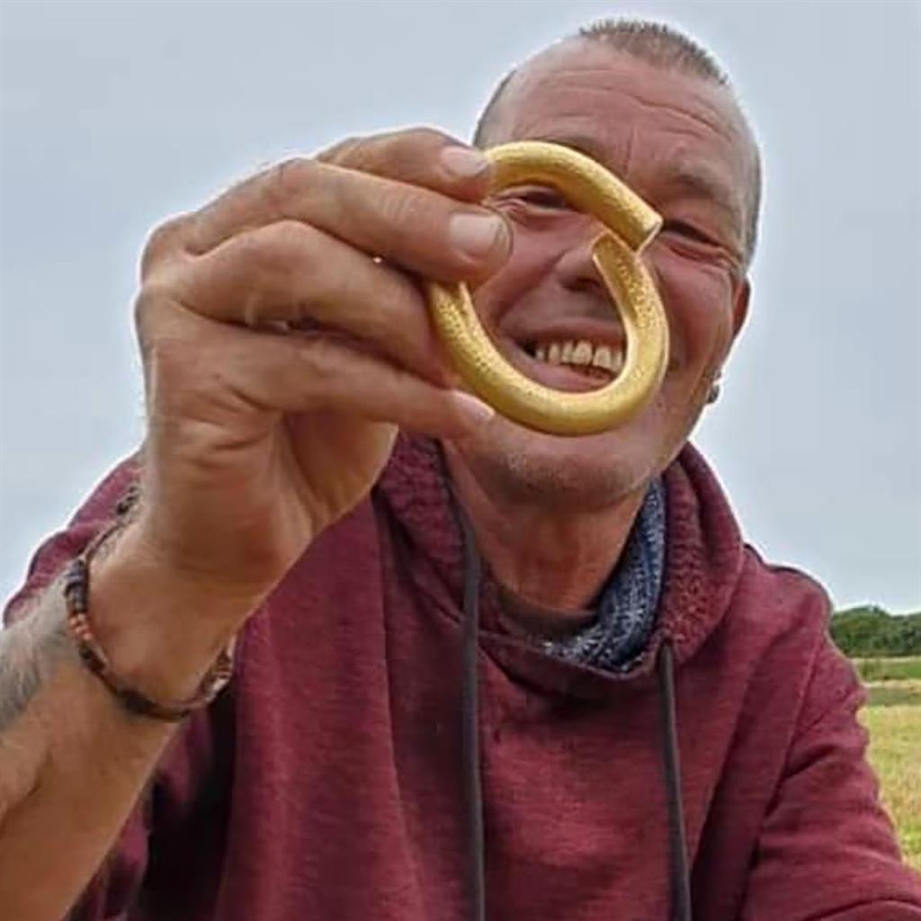 'Gobsmacked': Detectorist Billy Vaughan with Bronze Age torc worth thousands of pounds PICTURE: BNPS