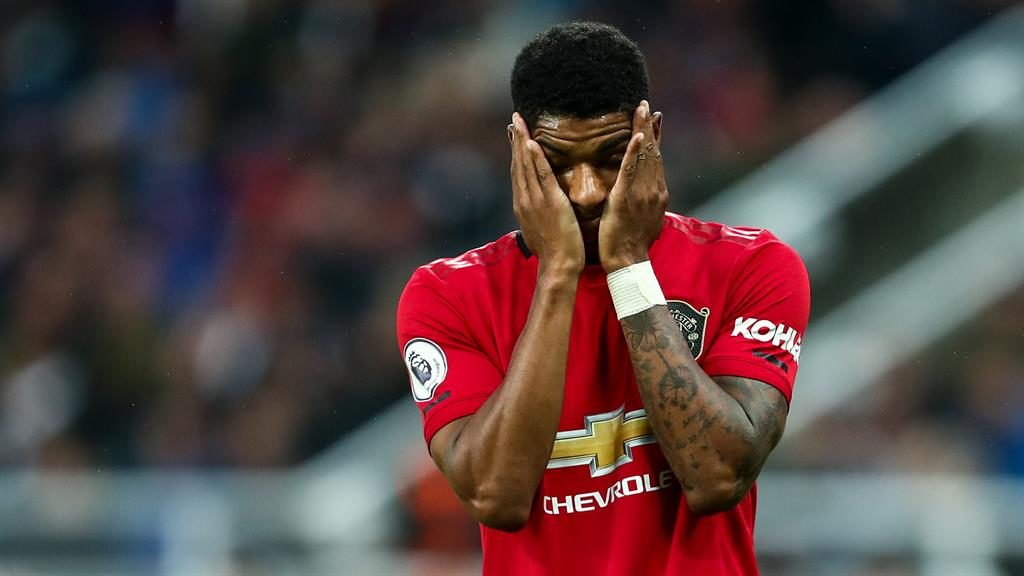 Headache: Rashford apologised for United's display at Newcastle but the club are sticking with Solskjaer (below) PICTURES: GETTY