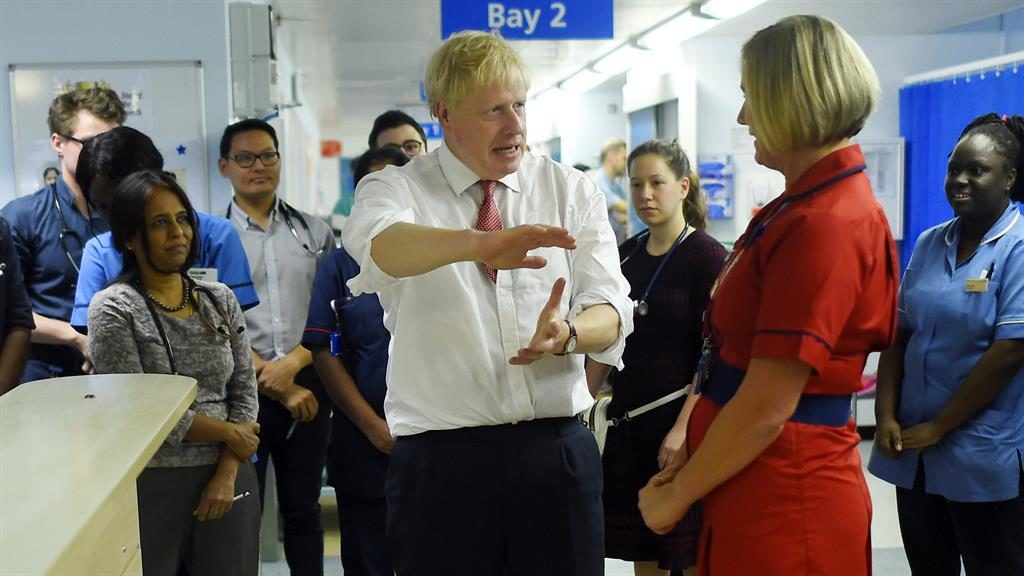 Doing the rounds: Boris Johnson chats to staff at Watford General Hospital PICTURE: PA