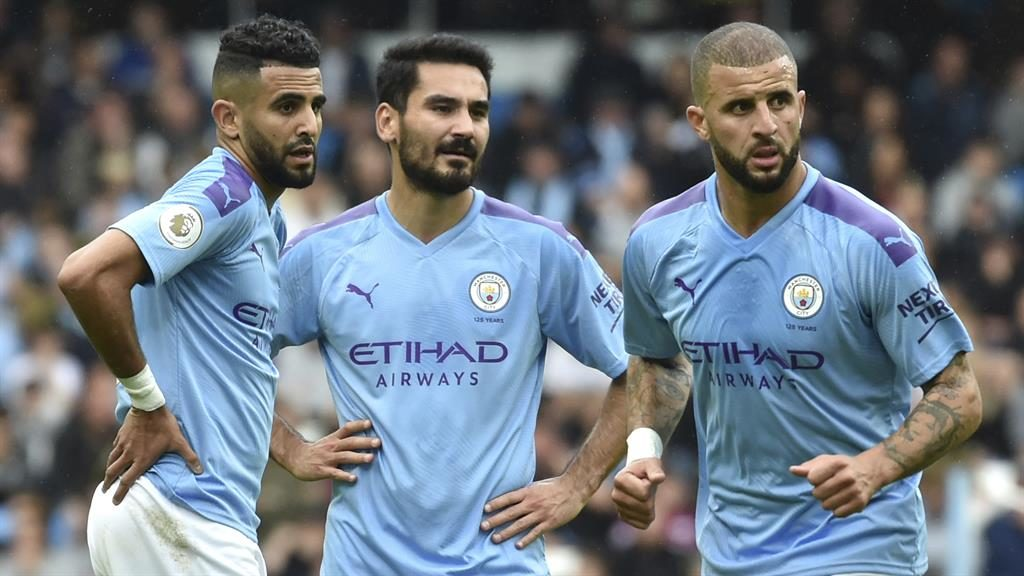 Watching in horror: (From left) Riyad Mahrez, Gundogan and Kyle Walker look worried against Wolves PICTURE: AP