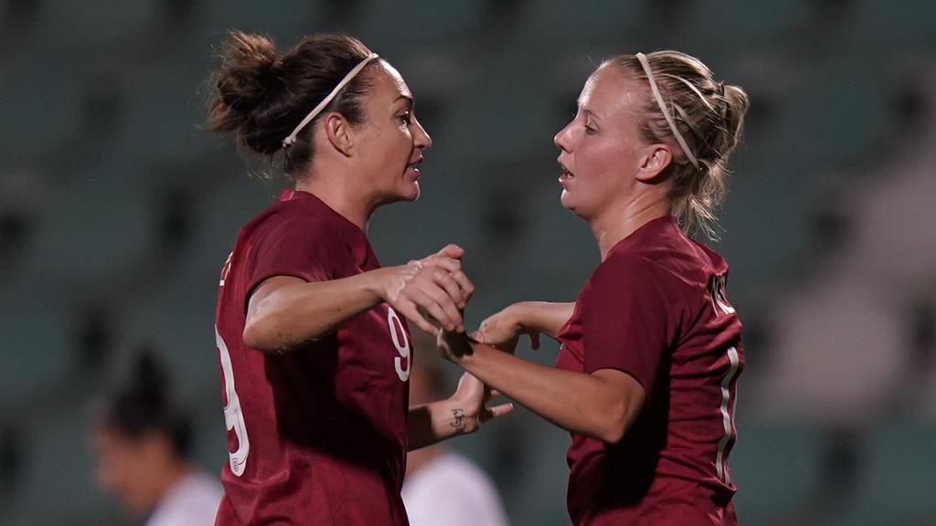 Morale booster: Mead (right) celebrates her goal with substitute Taylor PICTURE: GETTY