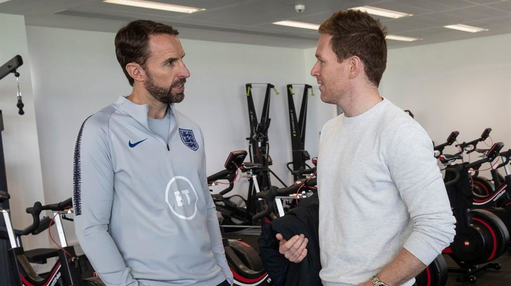 World beater: Morgan chats to Southgate (left) at St George's Park yesterday PICTURE: REX