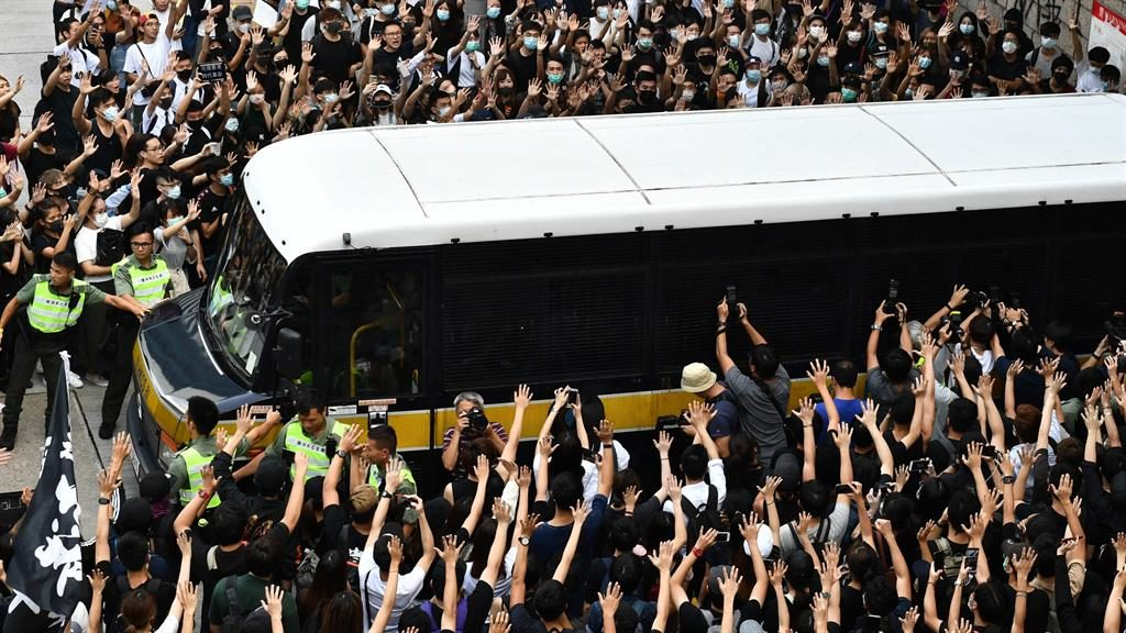 'Our hero': Supporters surround bus with activist Edward Leung inside PICTURE: AFP/GETTY