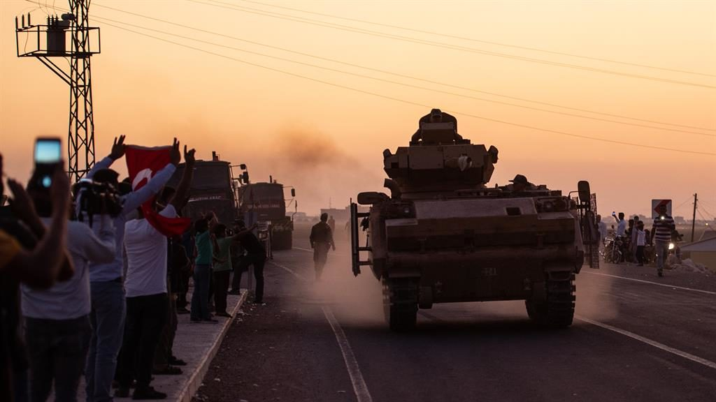 Invasion force: Turkish troops prepare to cross the border into Syria PICTURE: BURAK KARA/GETTY