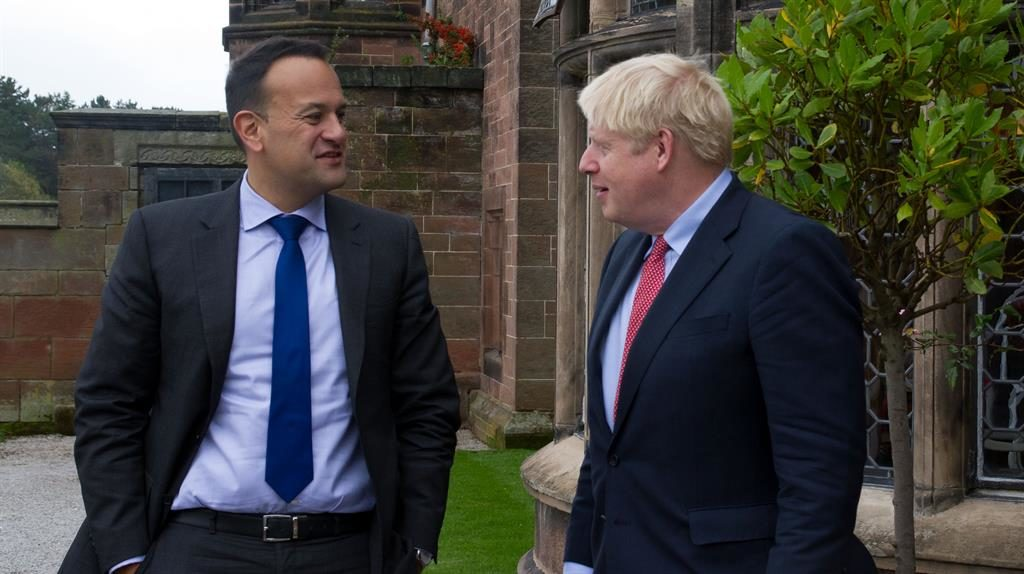 Walk the walk: Boris Johnson greets Leo Varadkar before the pair said they could see a 'pathway' to a deal PICTURE: GETTY