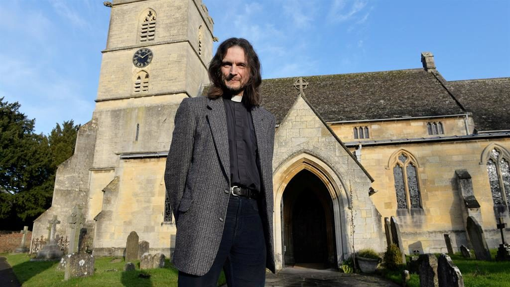 Grave situation: The Rev Nick Bromfield says ghost-hunters have been invading churchyard looking for Black Abbot PICTURES: SWNS