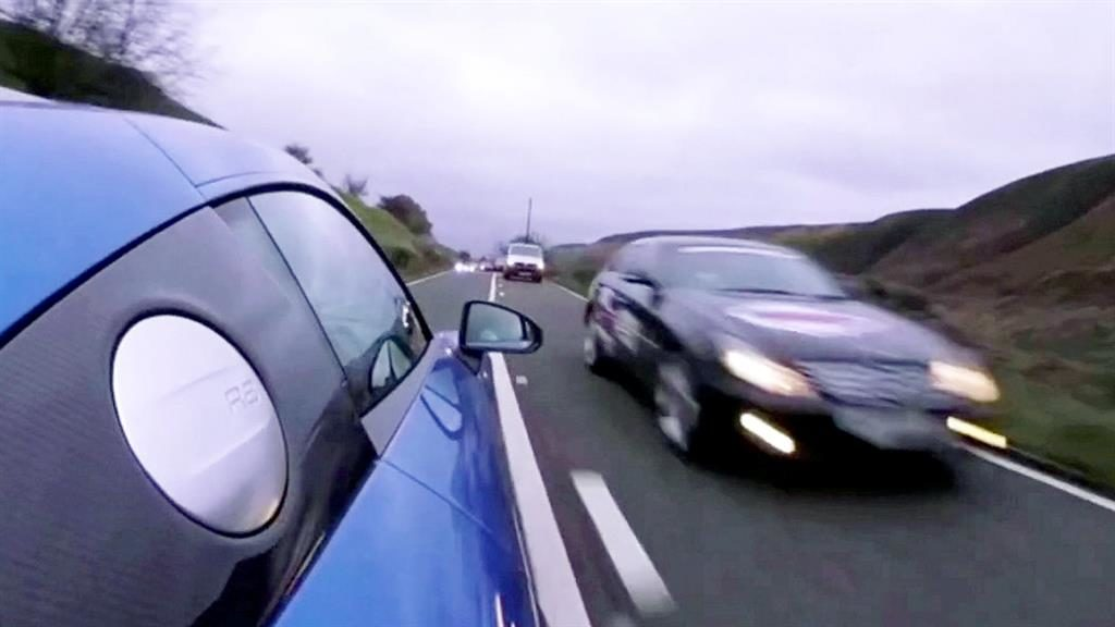 It's all a blur: The Audi R8 driven by Joe Achilles (below) on the journey along the A57 in the Peak District that he posted online PICTURES: DERBYSHIRE POLICE/ SWNS