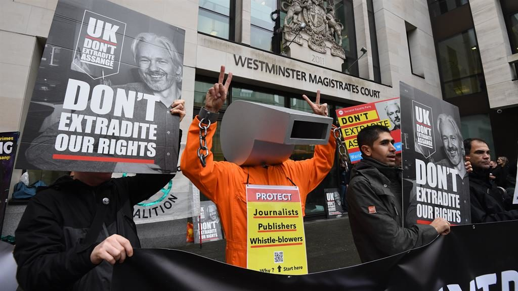 Controversial case: Supporters of WikiLeaks founder Julian Assange (below, in a court sketch) protest yesterday PICTURES: PA