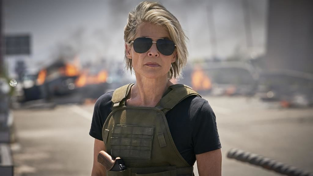 'Hands-down incredible': Linda Hamilton and (below) with 'frenemy' Arnie SKYDANCE/PARAMOUNT