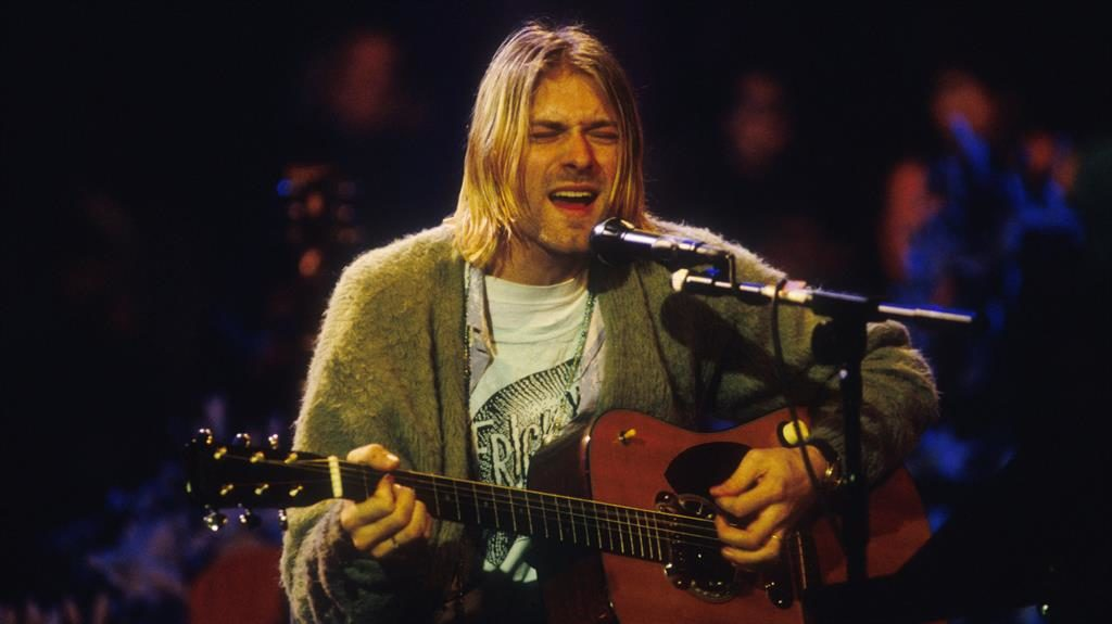 Top dollars: Cobain wore cardigan (below) on MTV Unplugged in 1993 PICTURES: FRANK MICELOTTA/DAVID WILLEMS