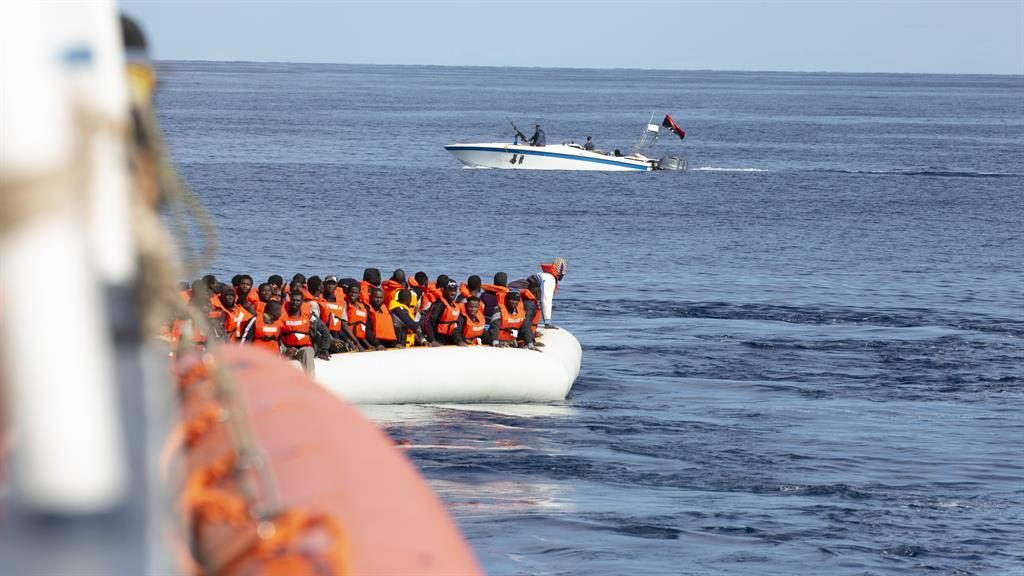 Under fire: Shots came from Libyan boats during rescue mission PICTURE: SEA-EYE/PA