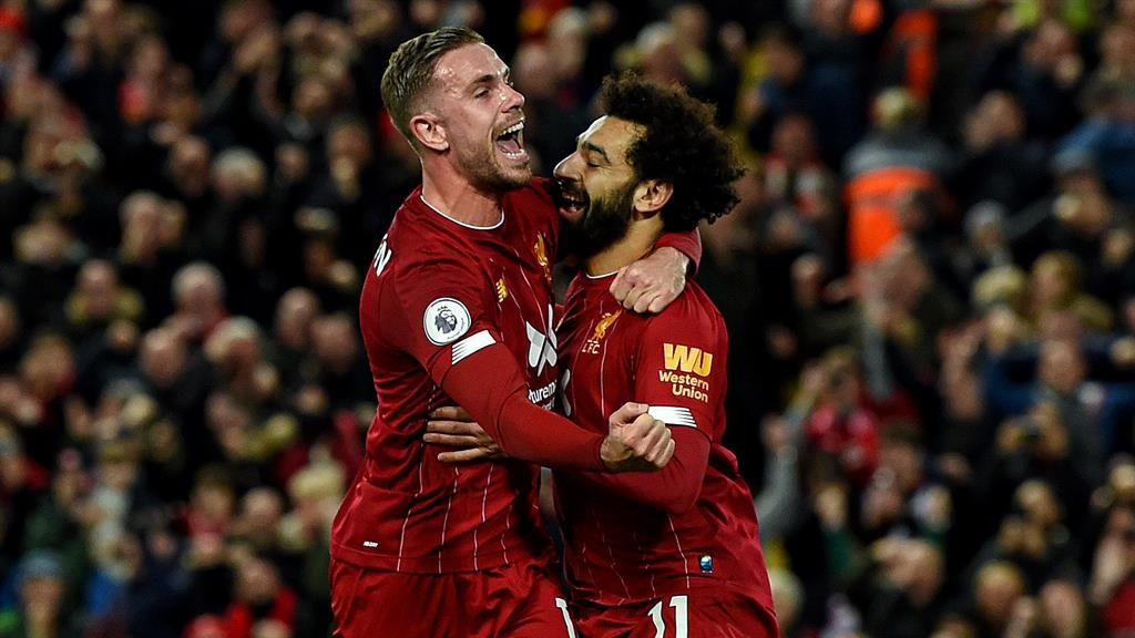 Red hot Henderson, who hit Liverpool's equaliser hugs Salah after his decisive penalty
