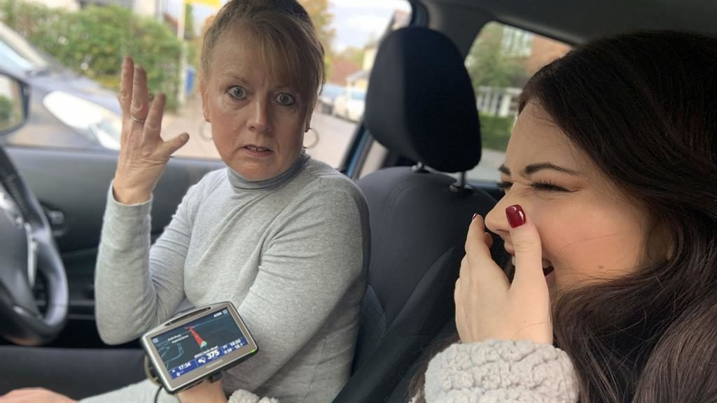 End of the rude: Tracy Dockerill and her daughter Jade with the satnav PICTURE: KENNEDY NEWS AND MEDIA
