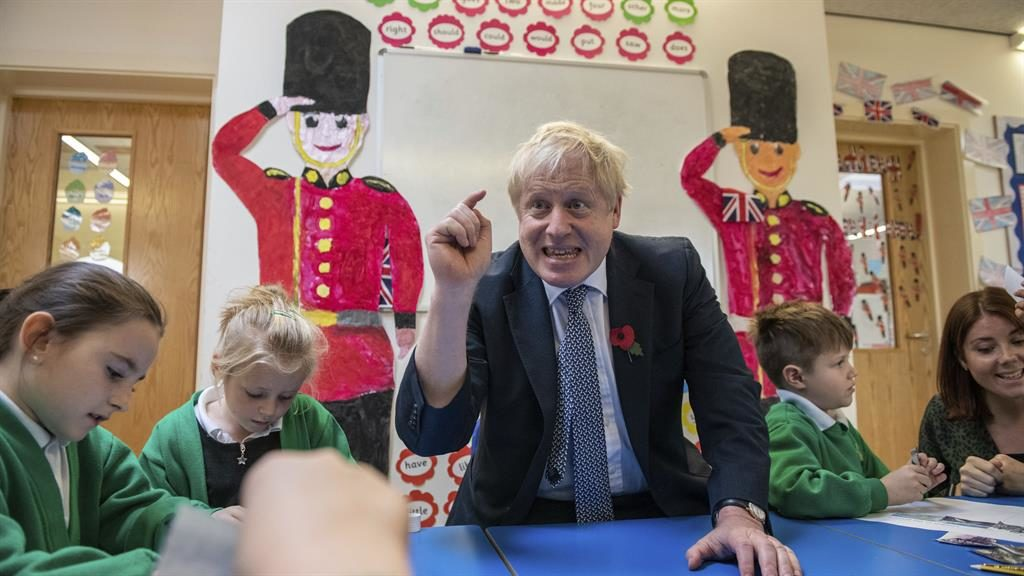 Soldiering on: Boris Johnson joined a class at a school in Bury St Edmunds PICTURE: AP