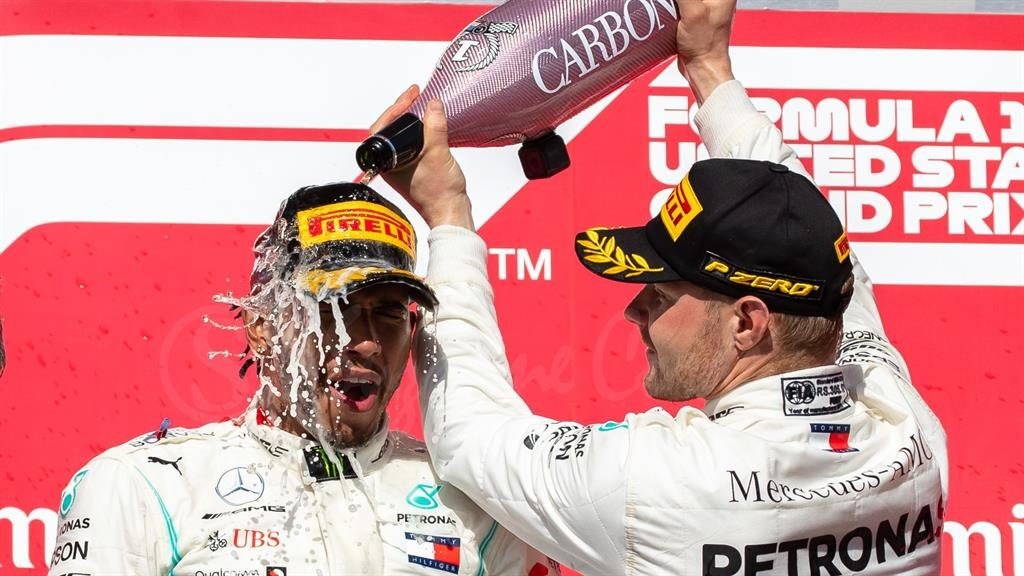 Congratulations: Fellow team-members Lewis Hamilton and Valtteri Bottas celebrate their top two podium places in Austin, Texas PICTURE: GETTY