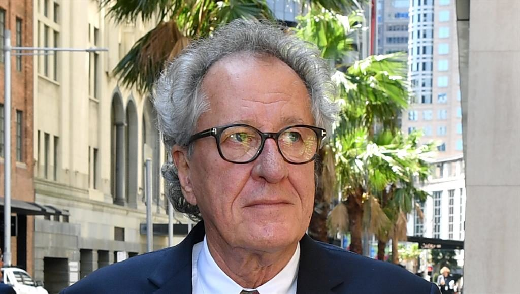 Outside court: Geoffrey Rush PICTURE: EPA