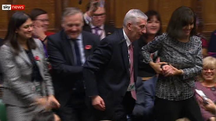 Tradition: Sir Lindsay Hoyle is dragged from the backbenches by Caroline Flint and Nigel Evans